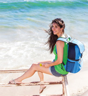 Woman at Beach with Picnic Time Zuma Backpack Cooler